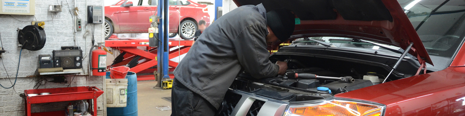 Auto Mechanic making auto diagnosis